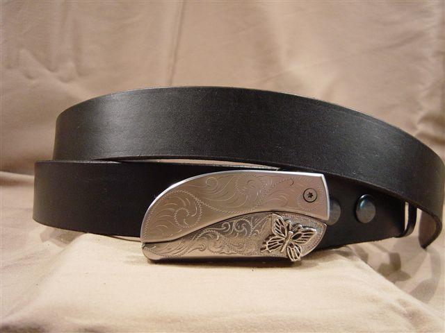 black leather belt with belt buckle knife