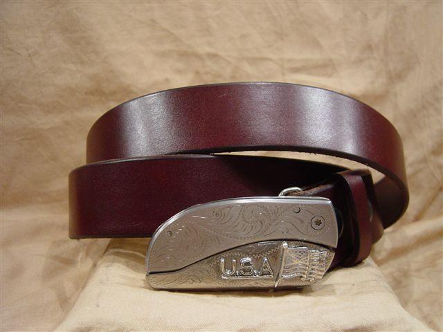 burgundy leather belt with belt buckle knife