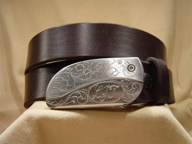 dark brown leather belt with belt buckle knife