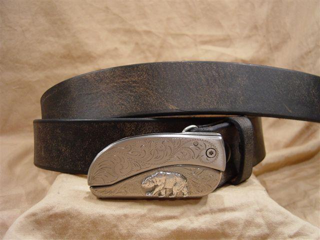 distressed black leather belt with belt buckle knife