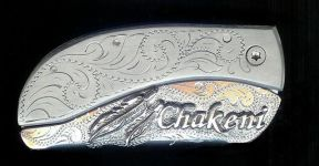 engraved scroll with sterling silver feathers and seven letter name Chakeni belt buckle knife