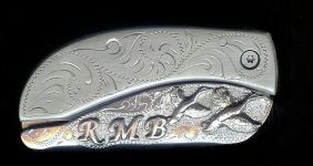 engraved scroll with sterling silver initials and two ducks belt buckle knife