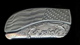 flag engraved scroll with sterling silver six guns and the name asshole dress belt buckle knife