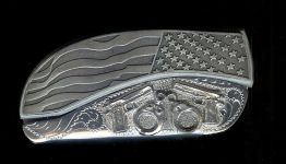 flag engraved scroll with two sterling silver 45's and handcuffs belt buckle knife