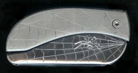 spider web with spider belt buckle knife