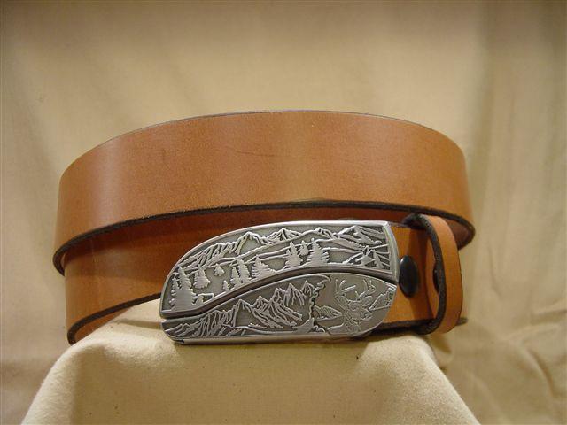 tan leather belt with belt buckle knife