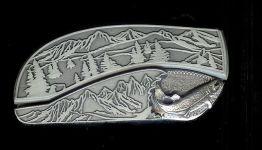 tree scene with custom sterling silver trout belt buckle knife