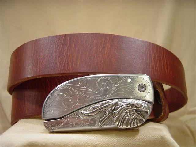 vintage tan leather belt with belt buckle knife